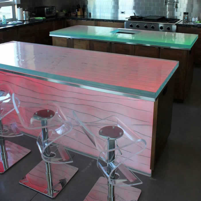 solid glass kitchen countertop with colored LED backlighting